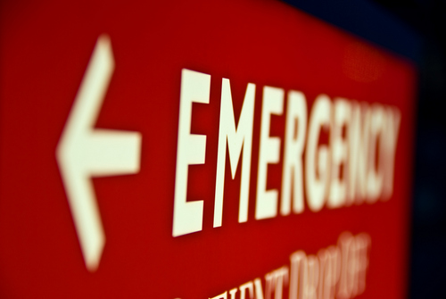 A close up of a red emergency sign